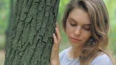 Beautiful , sad , lonely , young girl standing in the woods Stock Footage