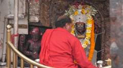 Priest preparing ceremony in Kali temple,Dakshinkali,Nepal Stock Footage