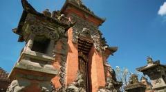 Beautiful orange balinese temple, dramatic tilt Stock Footage