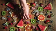 4k Colourful Composition of Fresh Fruits and Berries - Wooden Background Stock Footage