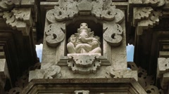 Ganesha stone figure in balinese gates, closeup Stock Footage