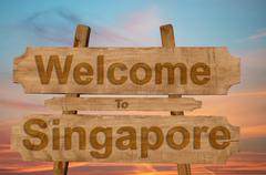 Welcome to Jamaica sign on wood background with blending national flag Stock Photos