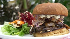 Organic Vegetarian Burger with Vegetables Greens and Carrot Stock Footage