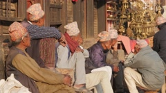 Nepali men chatting on square,Bhaktapur,Nepal Stock Footage