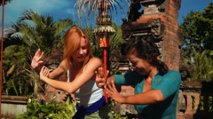 Balinese woman showing caucasian girl how to dance balinese style Stock Footage