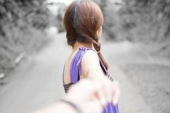 Young couple in love walking in the park and holding hands Stock Photos