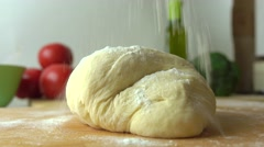 Cooking pizza, part of the set. Pouring flour and kneading the dough. 4K close Stock Footage