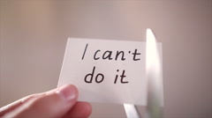 Man using scissors to remove the word can't to read I can do it concept for self Stock Footage