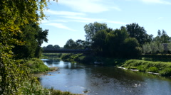 River with bridge in Dutch landscape Stock Footage