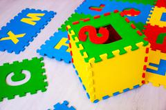 Colorful educational rugs for kids jigsaw puzzles, which are fashionable to c Stock Photos