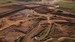 Clay pit - aerial view, sunny afternoon Stock Footage