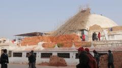 Giant stupa in repair after earthquake,Kathmandu,Boudhanath,Nepal Stock Footage