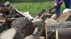 Blurred farmer man chop wood with axe. 4K Stock Footage