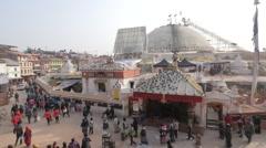 Buddhist people circle the stupa,Kathmandu,Boudhanath,Nepal Stock Footage