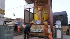 Man showing Buddhist statue,Kathmandu,Swayambhunath,Nepal Stock Footage