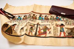 Coins, a flashlight and Egyptian papyrus Stock Photos