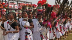Nepali traditional dance with women carrying water pot on head,Chitwan,National Stock Footage