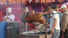 Pork barbeque at festival,Chitwan,National Park,Nepal Stock Footage