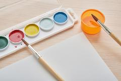 Album and paint on the desk Stock Photos