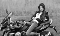 Biker girl,sexy biker girl with motorbike Stock Photos