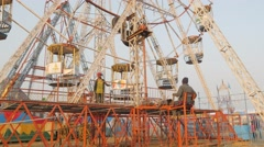 Man operating ferris wheel,Chitwan,National Park,Nepal Stock Footage