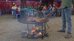 Barbeque at festival,Chitwan,National Park,Nepal Stock Footage