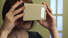 Young Woman in Virtual Reality Glasses cardboard. VR 360 Stock Footage