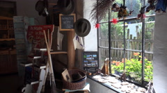 4k Small charcoal burner museum indoor shop with culture and craft articles Stock Footage