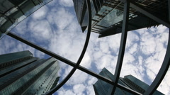 Time lapse of beautiful clouds reflected in mirrored facets of modern buildings Stock Footage