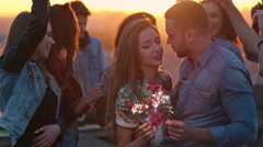 Romantic Couple Kissing at Rooftop Party Stock Footage