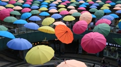 Colorful umbrellas swaying as interior design in shopping mall center Stock Footage