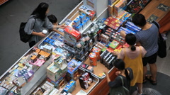 High angle view of people shopping around indoor market Stock Footage