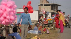 Busy street with balloons at fair,Chitwan,National Park,Nepal Stock Footage