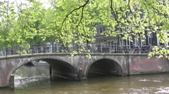 Beautiful view of Amsterdam canals with bridge and typical dutch houses Stock Footage