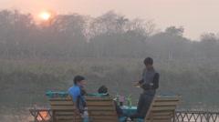Men enjoying beer at river bed,Chitwan,National Park,Nepal Stock Footage