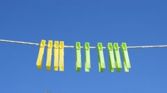 Clothespins on a rope Stock Footage