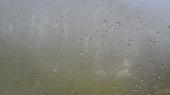 A hand cleans the misty window Stock Footage