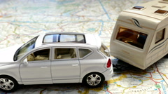Model car and caravan on a map. Stock Footage