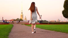 Happy travel girl in dress stroll and spin around at Spit of Vasilyevsky Island Stock Footage