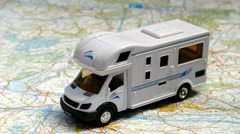 Model motorhome on a map. Stock Footage