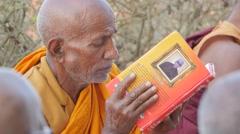 Buddhist pilgrim reading religious book,Lumbini,Nepal Stock Footage