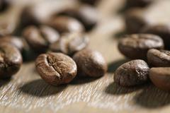 Coffee beans on oak wood background Stock Photos