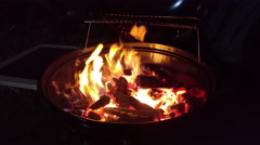Charcoal on fire in a BBQ grill barbecue, 4K Stock Footage