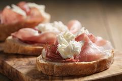 Simple ciabatta slices with speck and mozzarella Stock Photos