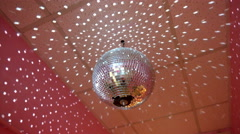 Mirror discoball spining around with reflection rays Stock Footage