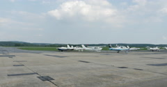 Small Airport with Many Single Engine Airplane Wide 10bit, 4K Stock Footage