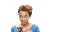Displeased young beautiful african girl looking at phone over white background Stock Footage