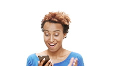 Surprised young beautiful african girl looking at phone overwhite background Stock Footage