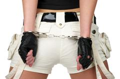 Sexy woman back with handcuffs Stock Photos