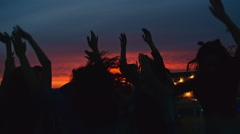 Ecstatic Crowd at Sunset Rooftop party Stock Footage
